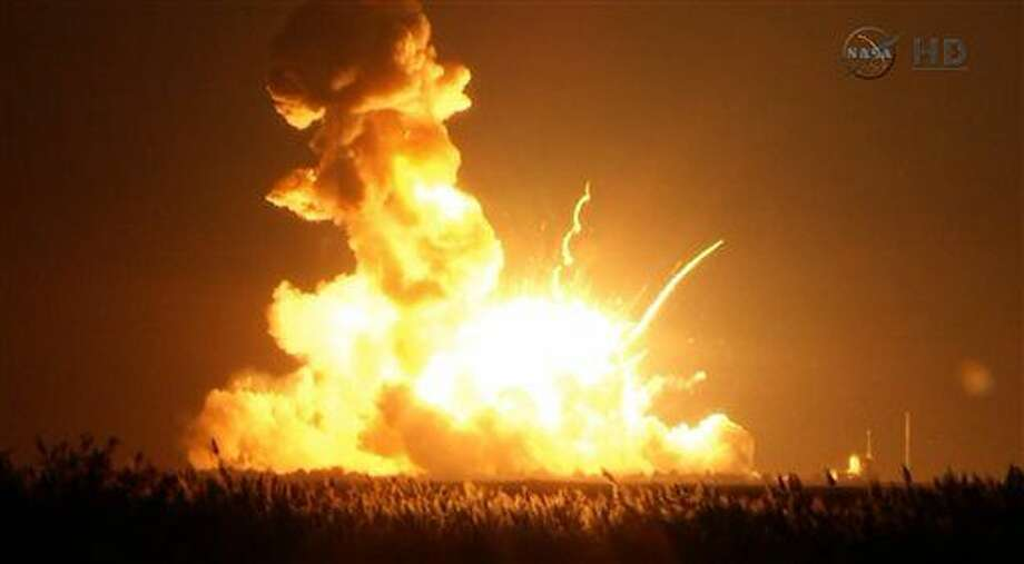 This image taken from video provided by NASA TV shows Orbital Sciences Corp.'s unmanned rocket blowing up over the launch complex at Wallops Island, Va., just six seconds after liftoff. The company says no one was believed to be hurt and the damage appeared to be limited to the facilities. (AP Photo/NASA TV) Photo: HOPD