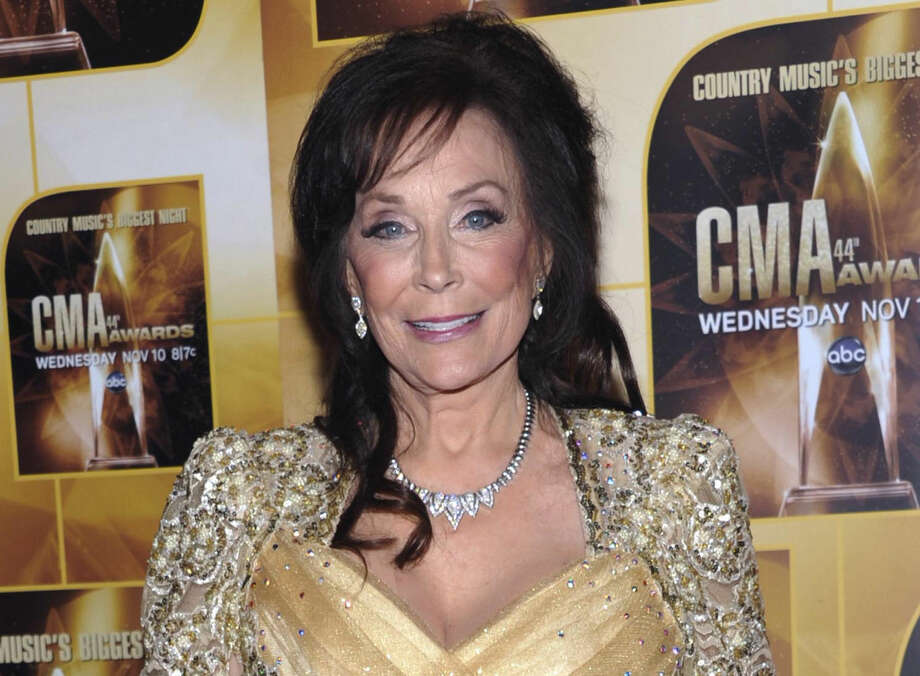 FILE - In this Nov. 10, 2010 file photo, singer Loretta Lynn poses in the press room during the 44th Annual Country Music Awards in Nashville, Tenn. Lynn celebrated 50 years of Grand Ole Opry membership Tuesday, Sept. 25, 2012 at the Opry House in Nashville. (AP Photo/Evan Agostini, File) Photo: Evan Agostini