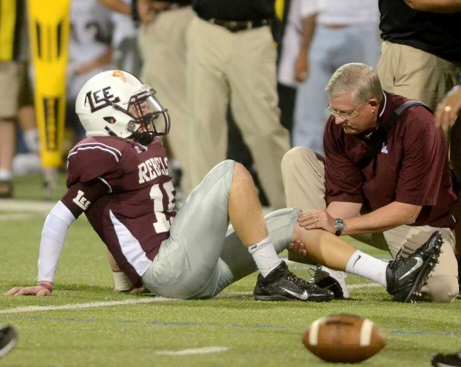 Lee High quarterback Wesley Hall is injured in the first half of play against Abilene High on Friday at Grande Communications Stadium. James Durbin/Reporter-Telegram Photo: James Durbin