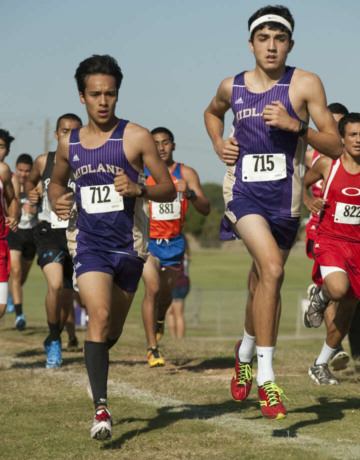 Midland High's Bryce Hoppel, #715 and Ruben Guerra, #712, race along the couse Thursday during the boys championship cross country meet at UTPB Park. Tim Fischer\Reporter-Telegram Photo: Tim Fischer