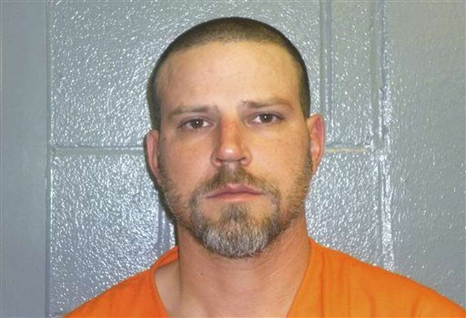 "This Dec. 9, 2015, booking photo provided by the Custer County, Okla., Sheriff's Office shows Jeremy Doss Hardy, who was arrested for DUI after a brief pursuit on Interstate 40 in Custer County, Okla. Oklahoma state police say Hardy, jailed on a preliminary complaint of driving under the influence, is the ""only person'"" being investigated for a pair of suspected road rage killings along Interstate 40. Jessica Brown, Oklahoma State Bureau of Investigation spokeswoman, said Hardy and his vehicle are the ones described by victims and witnesses as the suspect vehicle involved in the shootings. (Custer County Sheriff's Office via AP) Photo: HOGP"