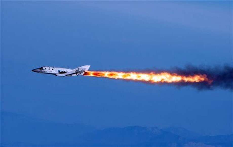 """In this April 29, 2013 file photo provided by Virgin Galactic shows Virgin Galactic's SpaceShipTwo under rocket power, over Mojave, Calif. Virgin Galactic has reported an unspecified problem during a test flight of its SpaceShipTwo space tourism rocket. The company tweeted Friday, Oct. 31, 2014, morning that SpaceShipTwo was flying under rocket power and then tweeted that it had """"experienced an in-flight anomaly."""" The tweet said more information would be forthcoming. (AP Photo/Virgin Galactic, Mark Greenberg, File) Photo: Mark Greenberg"""