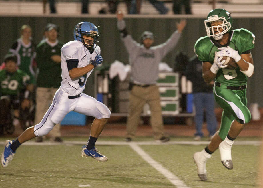Monahans' Marcus Montez catches a pass beating Greenwood's Lane Gonzales for a touchdown on the first play of the game. Tim Fischer\Reporter-Telegram Photo: Tim Fischer