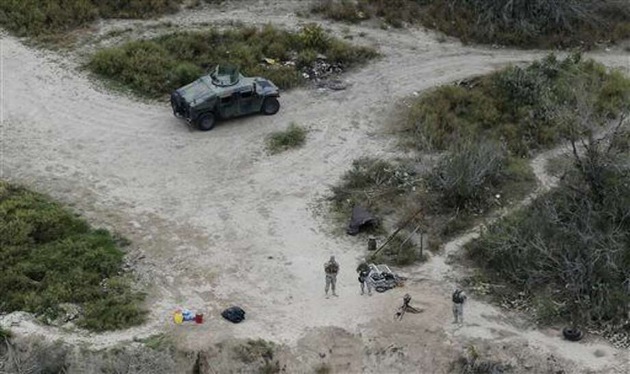 FILE - In this Feb. 24, 2015 file photo, members of the National Guard patrol along the Rio Grande at the Texas-Mexico border, in Rio Grande City, Texas. Republican Texas Gov. Greg Abbott on Tuesday, Dec. 15, 2015, extended the deployment of National Guard troops at the Mexico border due to a spike in the number of unaccompanied minors entering the country. (AP Photo/Eric Gay, File) Photo: Eric Gay
