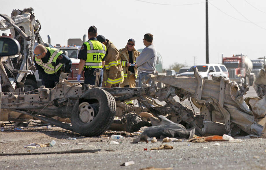 Emergency personnel work the scene of a vehicle wreck near the intersection of E Hwy 158 and County Rd 130 on Saturday. James Durbin/Reporter-Telegram Photo: James Durbin