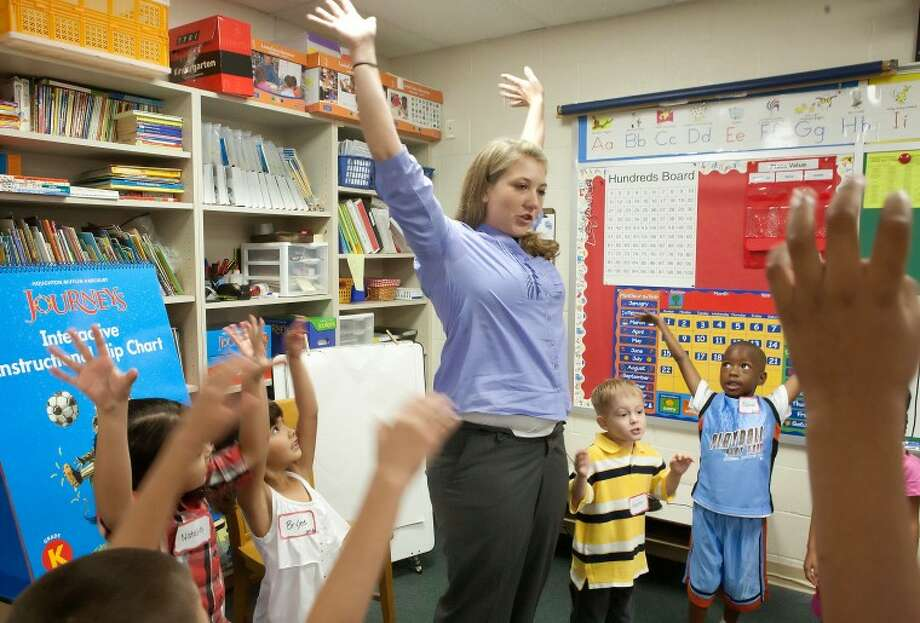 """First year teacher Melissa Schwartz and her kindergartners prepare for their first day of school with the """"Get Ready"""" song Monday at Milam Elementary School in 2010.MISD Superintendent Ryder Warren announced in a letter to parents on Oct. 17 that, effective Oct. 20, Milam Elementary School's principal, Carlton Johnson, will be assistant principal at the Midland Alternative Program while Milam's assistant principal, Iliana Bermea, is now campus principal. Photo: Cindeka Nealy/Reporter-Telegram"""
