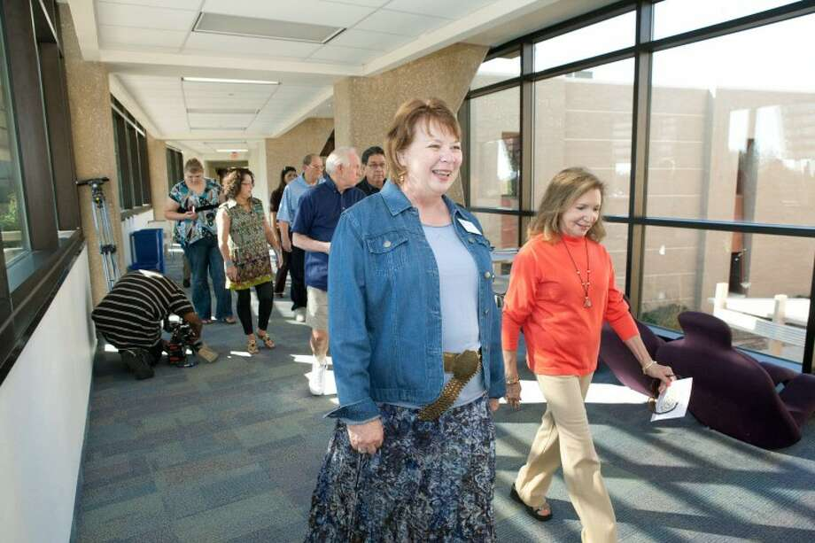 In this MRT file photo, Margaret Wade, left, gives Betty Basham and members of her group a tour of the Fox Science Building, during a Open House of the New Facilities on the Midland College Campus in October of 2010. Photo: Reporter-Telegram
