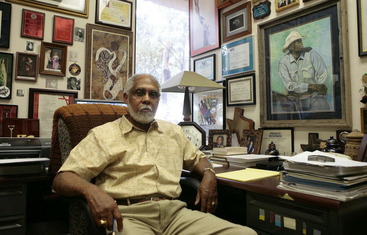 School Board member James Fuller sits in his office.