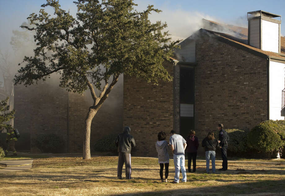 Residents stand outside of their apartments Friday 12-18-2015 morning waiting for first responders to tackle a fire at The Annex Apartments at 5100 North A Street. Tim Fischer\Reporter-Telegram Photo: Tim Fischer