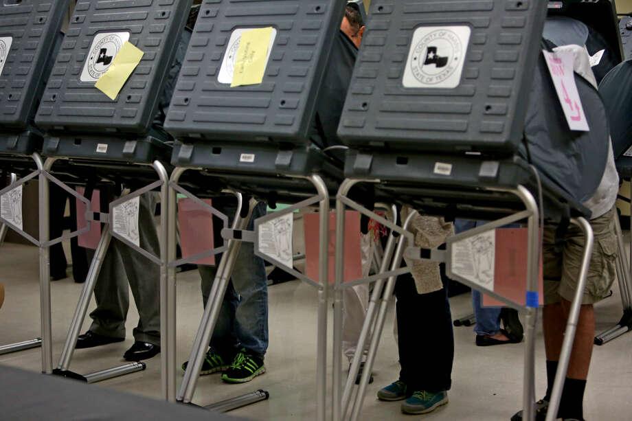 Voters mark their ballots at early voting at State Representative District 134M at the Metropolitan Multi Service Center on West Gray Monday, Oct. 20, 2014, in Houston, Texas. ( Gary Coronado / Houston Chronicle ) Photo: Gary Coronado