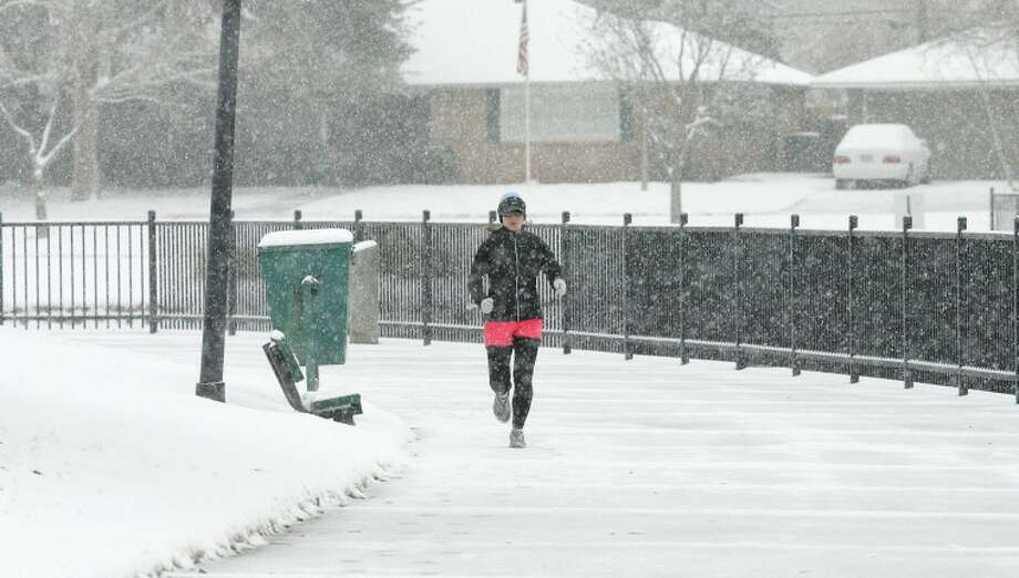 In this 2011 file photo, Kimberly Vest didn't let the snow stop her from running 15 miles as she trained at Wadley-Barron Park for a marathon. Photo: Reporter-Telegram File Photo