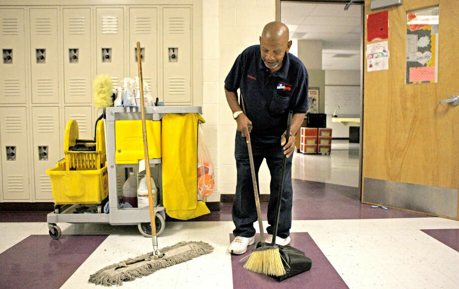 Archie Williams, custodian at Midland Freshman High School, at work on Monday at the school. James Durbin/Reporter-Telegram Photo: James Durbin