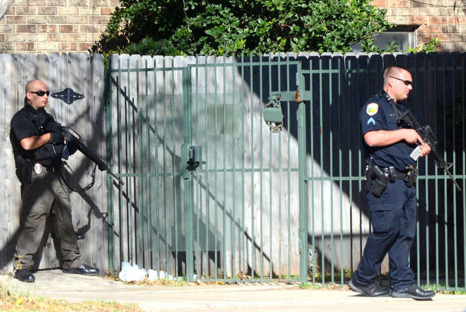 Public safety professionals from multiple agencies work the area surrounding the Clayton Town Home Apartments where two Odessa Police officers were shot while serving a warrant, Wednesday, Dec. 23, 2015 in Odessa. James Durbin/Reporter-Telegram Photo: James Durbin