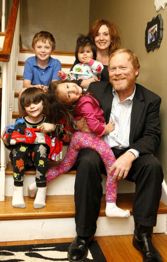 Jeff Robnett, candidate for School Board District Four pauses for a photo with his family Tuesday at his home after early voting results were released. Children from top left Oliver, age 9, Storrie, 11 months, Colt, age 5, Lilly, age 3. Wife, Dila is on top row right. James Durbin/Reporter-Telegram Photo: James Durbin