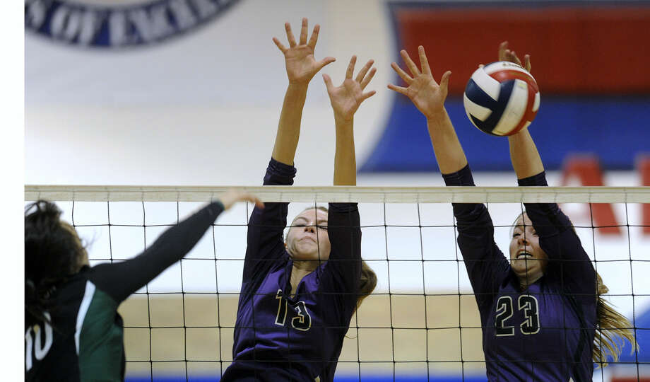 Thomas Metthe/Reporter-News Midland High's Erin Robbins (13) and Jenna Gillean (23) attempt to block the shot of Arlington High's Baylee Bates (10) during the first set of Midland High's match in the Region I-6A bi-district playoffs on Monday, Nov. 3, 2014, at Cooper High School in Abilene. Photo: Thomas Metthe