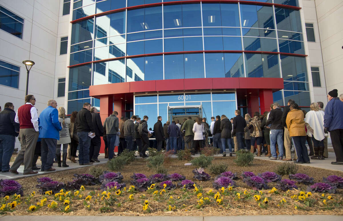Visitors and guests make their way inside Friday 12-18-2015 at the opening of the new Occidental Petroleum Corporation Midland office complex. Tim Fischer\Reporter-Telegram