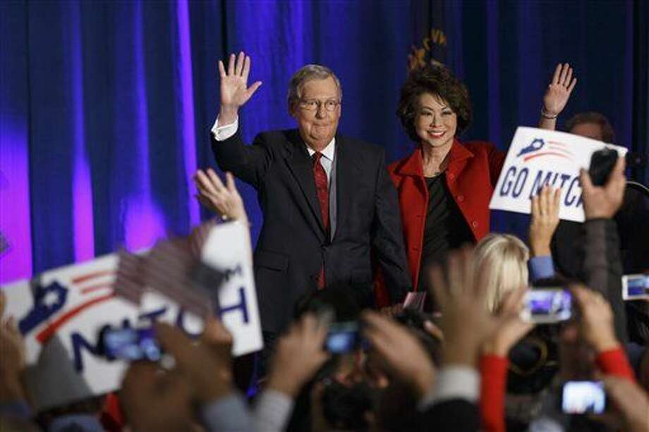 Senate Minority Leader Mitch McConnell of Ky., joined by his wife, former Labor Secretary Elaine Chao, celebrates with his supporters at an election night party in Louisville, Ky., on Tuesday. Photo: J. Scott Applewhite