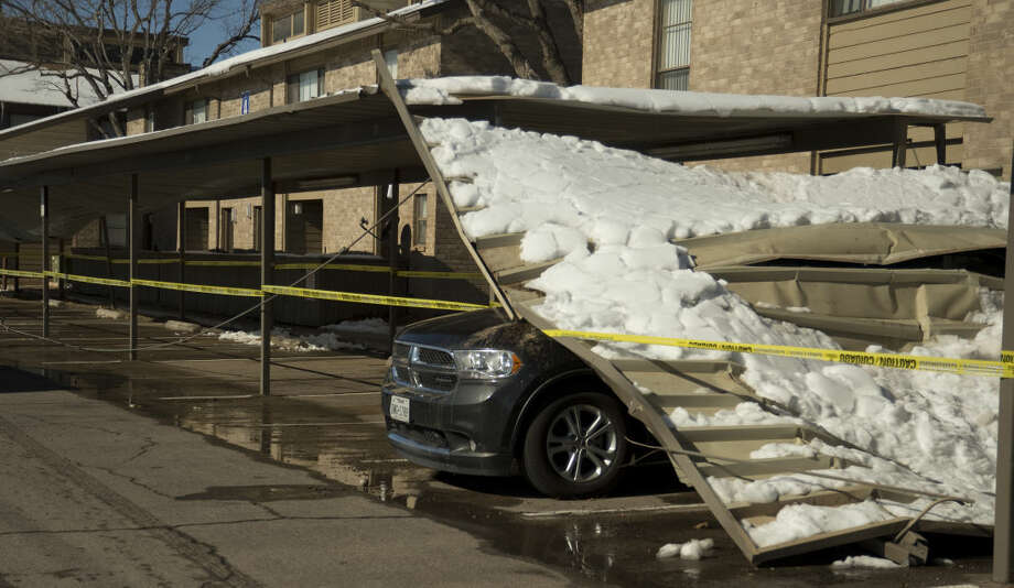 Carports at Andrews Square West Apartment Homes collapsed overnight with the weight of snow on them. Tuesday 12-29-2015 Tim Fischer\Reporter-Telegram Photo: Tim Fischer