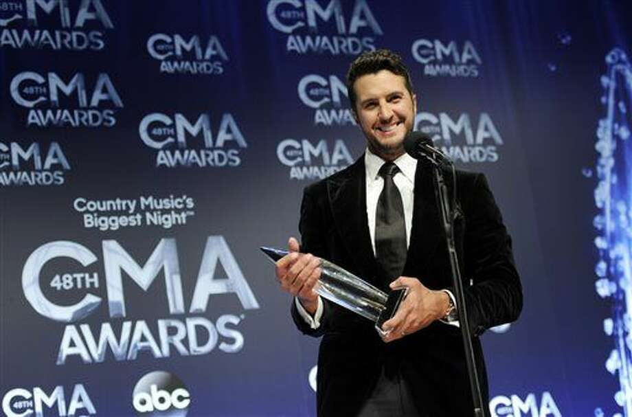 Luke Bryan poses in the press room with the award for entertainer of the year at the 48th annual CMA Awards at the Bridgestone Arena on Wednesday, Nov. 5, 2014, in Nashville, Tenn. Photo: Photo By Evan Agostini/Invision/AP