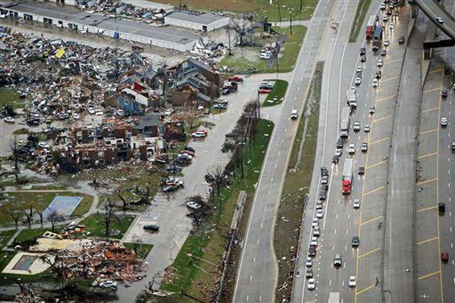 Traffic backs up along I-30, right near a site of Saturday's tornado in Garland, Texas, Sunday, Dec. 27, 2015. At least 11 people died and dozens were injured in apparently strong tornadoes that swept through the Dallas area and caused substantial damage this weekend. (G.J. McCarthy/The Dallas Morning News via AP) MANDATORY CREDIT Photo: G.J. McCarthy
