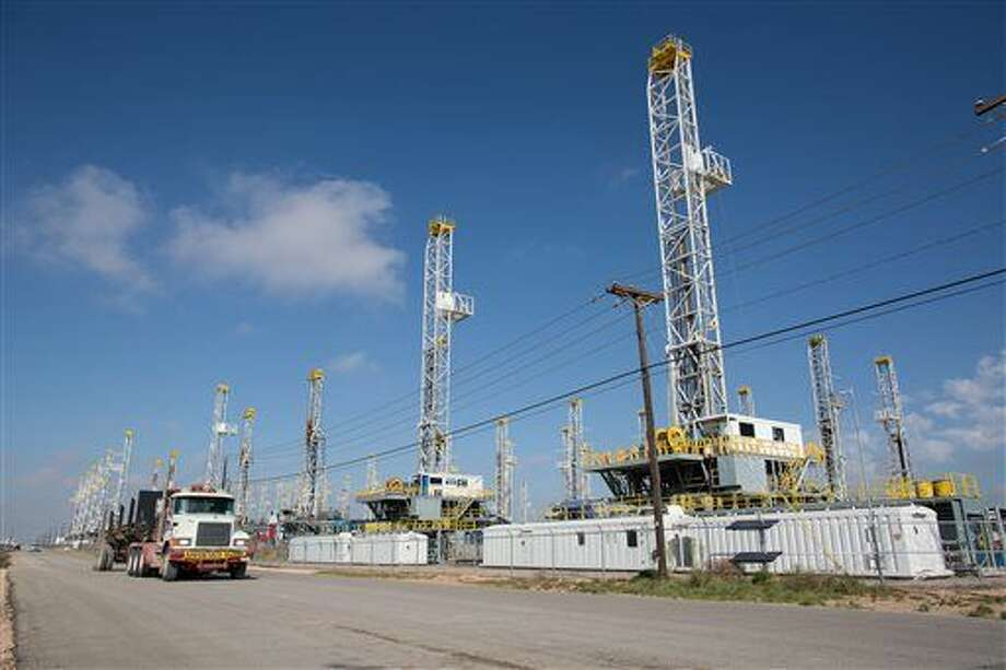 FILE - In this Monday, May 18, 2015, file photo, more than 30 oil drilling rigs are idle in a Helmerich & Payne, Inc. yard along Groening Street in Odessa, Texas, as rig counts drop in the Permian Basin. The drilling boom, driven by high oil prices and new discoveries, brought tens of thousands of workers to oil fields in several states to run drilling rigs and supply the equipment and services needed to produce crude. Then the price of oil tanked, plummeting by half in late 2014 and reaching levels in 2015 not seen since the financial crisis. Oil companies abandoned drilling projects and began laying off workers. (Courtney Sacco/Odessa American via AP, File) MANDATORY CREDIT Photo: Courtney Sacco