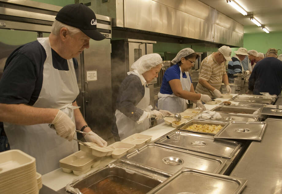 John Marshall and others prepare the hot meals Wednesday for Meals on Wheels as HEB kicks off their Feast of Sharing for Midland with all meals donated by HEB. Tim Fischer\Reporter-Telegram Photo: Tim Fischer