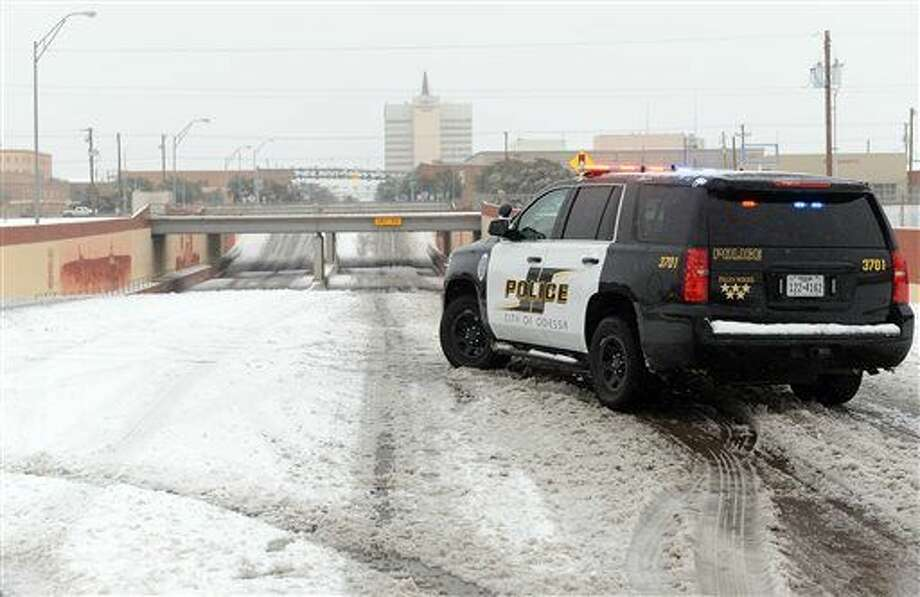 Odessa Police block access to the railroad underpass on Grant Avenue near Second Street, Sunday, Dec. 27, 2015, in Odessa, Texas. Nearly all of Interstate 40 in Texas, the main east-west highway through the Texas Panhandle, has been shut because of the snowstorm pummeling the area. The Texas Department of Public Safety says only a small section of the highway within Amarillo is not closed. (Mark Sterkel/Odessa American via AP) MANDATORY CREDIT Photo: Mark Sterkel