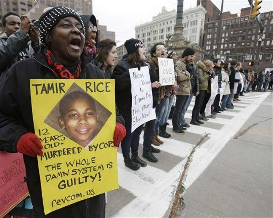FILE - This Nov. 25, 2014, file photo, shows demonstrators blocking Public Square in Cleveland, during a protest over the police shooting of 12-year-old Tamir Rice. A decision on whether to charge two white officers in the death of Tamir Rice, one of the higher-profile cases of black deaths at the hands of officers that have roiled cities nationwide, could come any day. The grand jury making the decision has been meeting since mid-October. (AP Photo/Tony Dejak, File) Photo: Tony Dejak