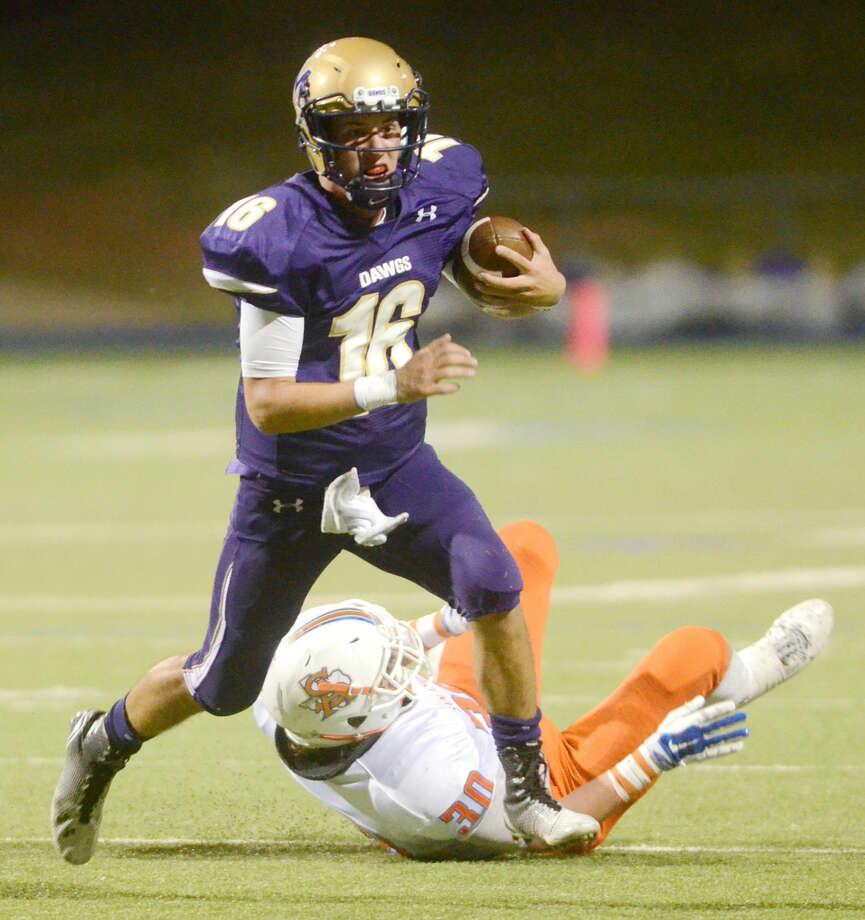 Midland High quarterback Ryan Goodrum runs against San Angelo Central on Friday at Midland High. James Durbin/Reporter-Telegram Photo: James Durbin