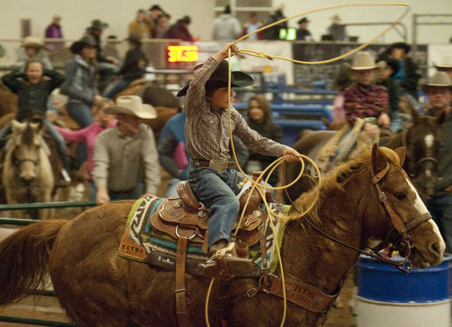 12-30-14 Brayden Cervantes chases a calf Tuesday afternoon at the New Year's Calf Roping Blowout at the Horseshoe Arena. Tim Fischer\Reporter-Telegram Photo: Tim Fischer