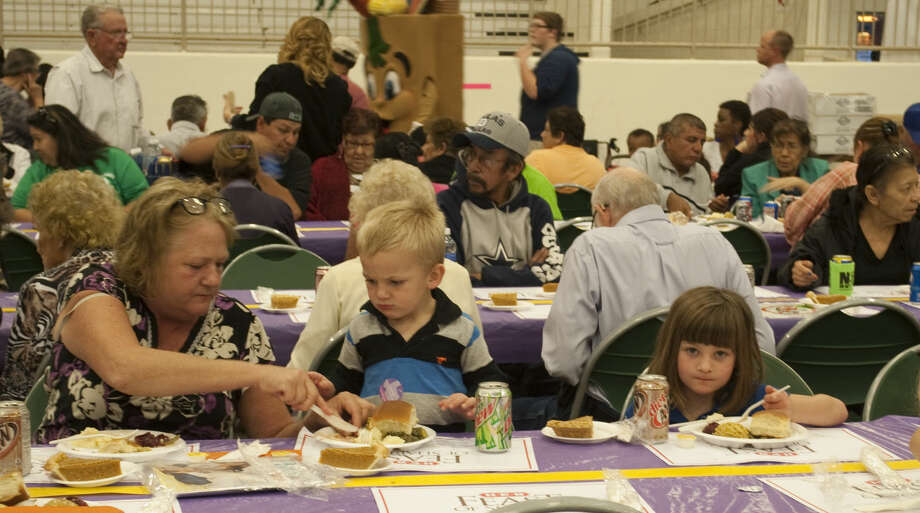 Thousands of area residents enjoy dinner Friday at the annual Feast of Sharing. Tim Fischer\Reporter-Telegram Photo: Tim Fischer