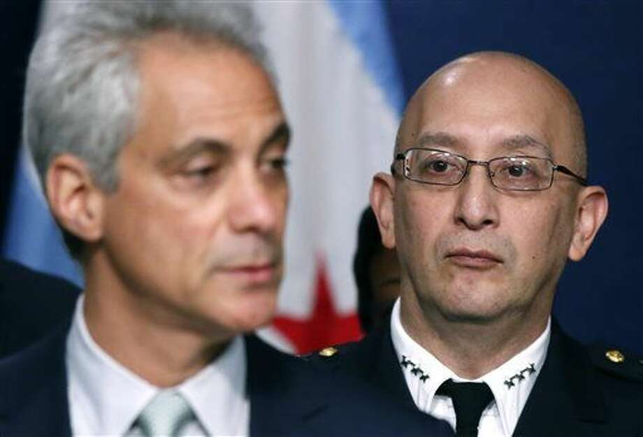 Chicago Police Superintendent John Escalante, right, listens to Chicago Mayor Rahm Emanuel during a news conference about new police procedures on Wednesday, Dec. 30, 2015, in Chicago. Emanuel says every Chicago police patrol car will be equipped with a Taser following a series of high-profile shootings by officers. (AP Photo/Charles Rex Arbogast) Photo: Charles Rex Arbogast