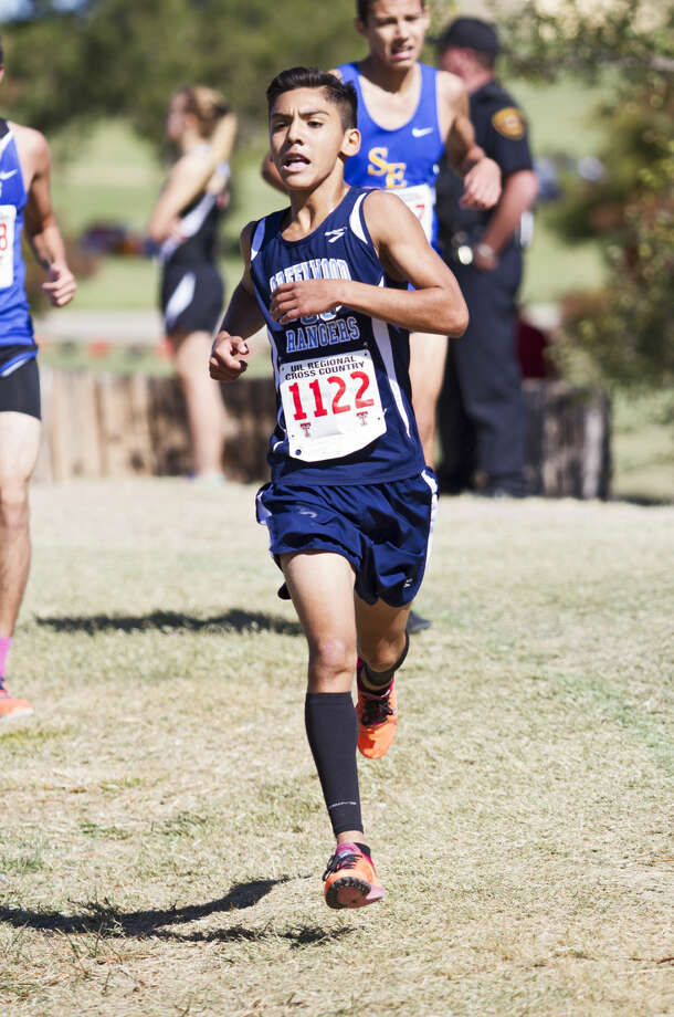 Midland Greenwood sophomore Exalander Magallan runs along the final stretch of the course during the UIL Region 1 Cross Country Championship on Friday at Mae Simmons Park in Lubbock. Magallan qualified for the state tournament with a 16:36.34 final time. Photo: Brad Tollefson