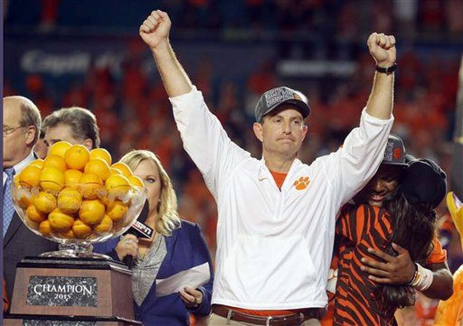 Clemson head coach Dabo Swinney raises his arms after winning the Orange Bowl NCAA college football semifinal playoff game against Oklahoma, Thursday, Dec. 31, 2015, in Miami Gardens, Fla. Clemson defeated Oklahoma 37-17 to advance to the championship game. (AP Photo/Lynne Sladky) Photo: Lynne Sladky