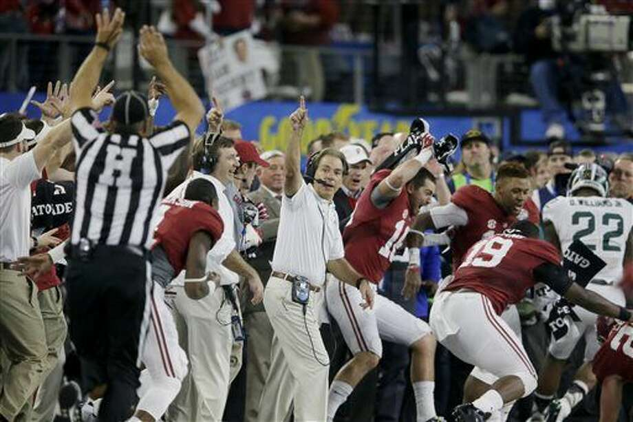 Alabama head coach Nick Saban and team take the field at the end of the Cotton Bowl NCAA college football semifinal playoff game against Michigan State, Thursday, Dec. 31, 2015, in Arlington. Alabama won 38-0 to advance to the championship game. (AP Photo/LM Otero) Photo: LM Otero