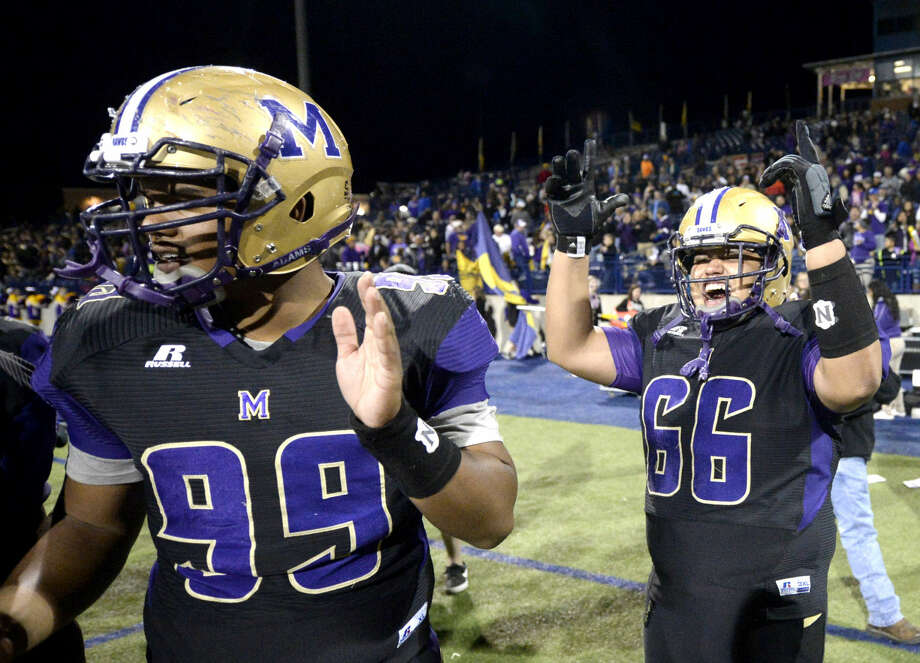 Midland High defensive lineman Jesse Carter (99) and defensive lineman Tito Salcido (66) celebrate after beating Lee to advance to the state playoffs on Friday, Nov. 6, 2015, at Grande Communications Stadium. James Durbin/Reporter-Telegram Photo: James Durbin