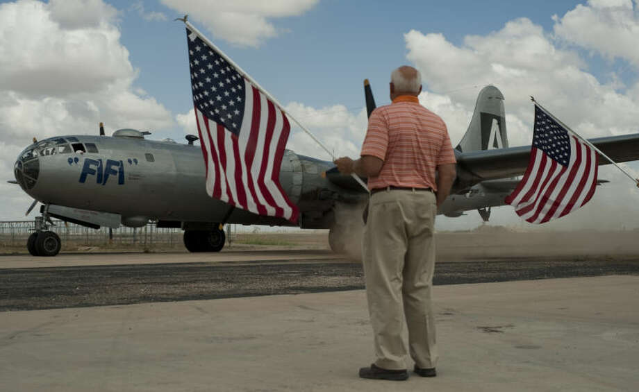 """Keith Lawrence and others welcome """"FiFi"""" home as they taxi the plane to the hanger at the CAF. """"FiFi,"""" the only flying B-29 airplane,came home for some scheduled maintenance and stopover tours of the aircraft. Tim Fischer\Reporter-Telegram Photo: Tim Fischer"""