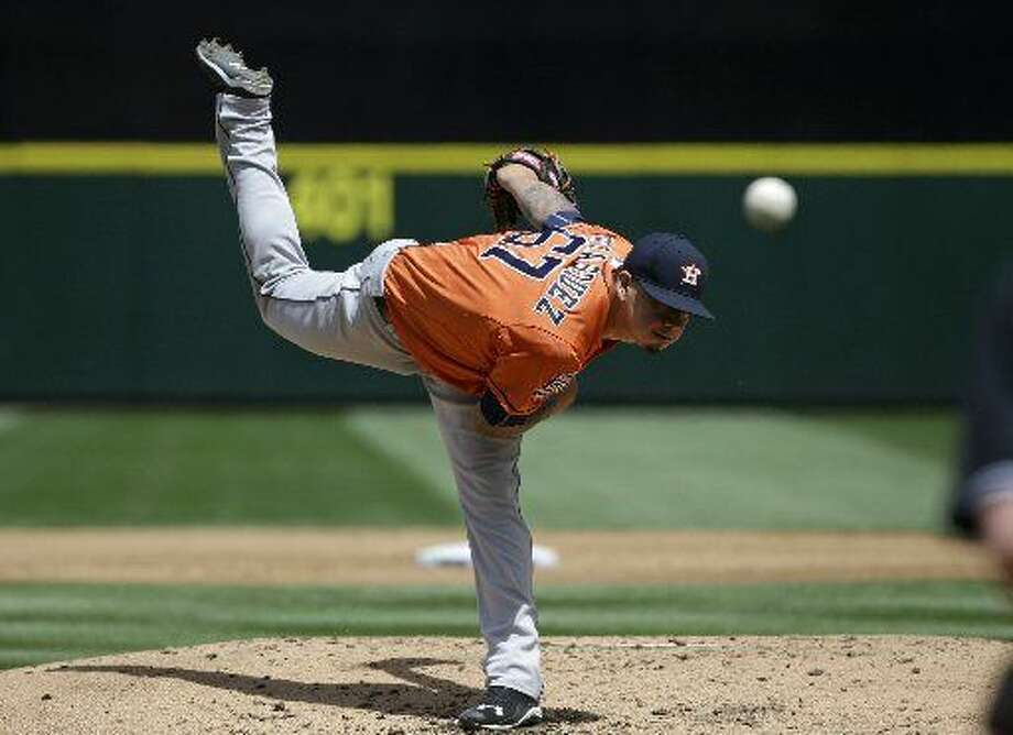 Houston Astros starting pitcher Vincent Velasquez throws against the Seattle Mariners in a baseball game Sunday, June 21, 2015, in Seattle. (AP Photo/Elaine Thompson)  Photo: Elaine Thompson | AP