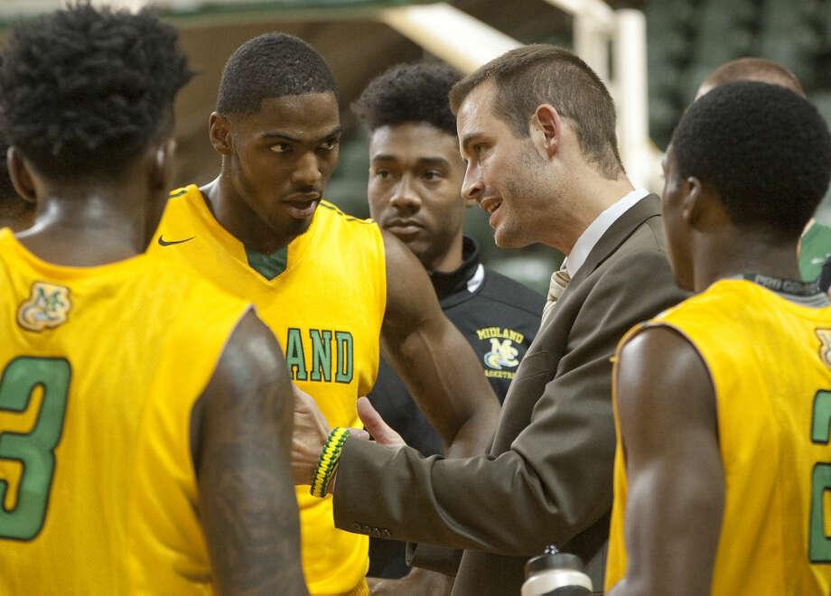 MC coach Jordan Dreiling talks with his players during a timeout Saturday in a game against Seward College. Tim Fischer\Reporter-Telegram Photo: Tim Fischer