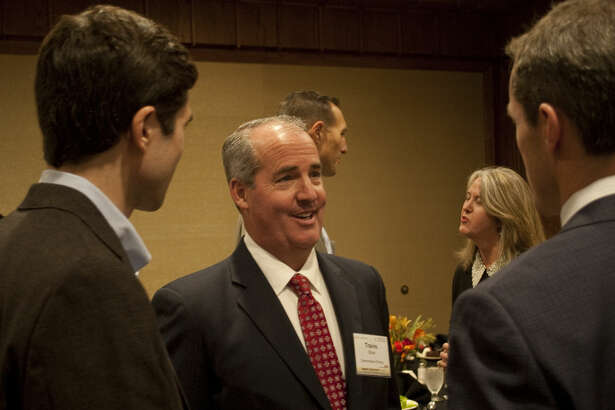 Travis Stice, center with Diamondback Energy, talks with Brian Seline and Chris Carter Monday evening at the 25th Energy Awards. Diamondback Energy was honored with the Energy Award for Company Performance. Tim Fischer\Reporter-Telegram