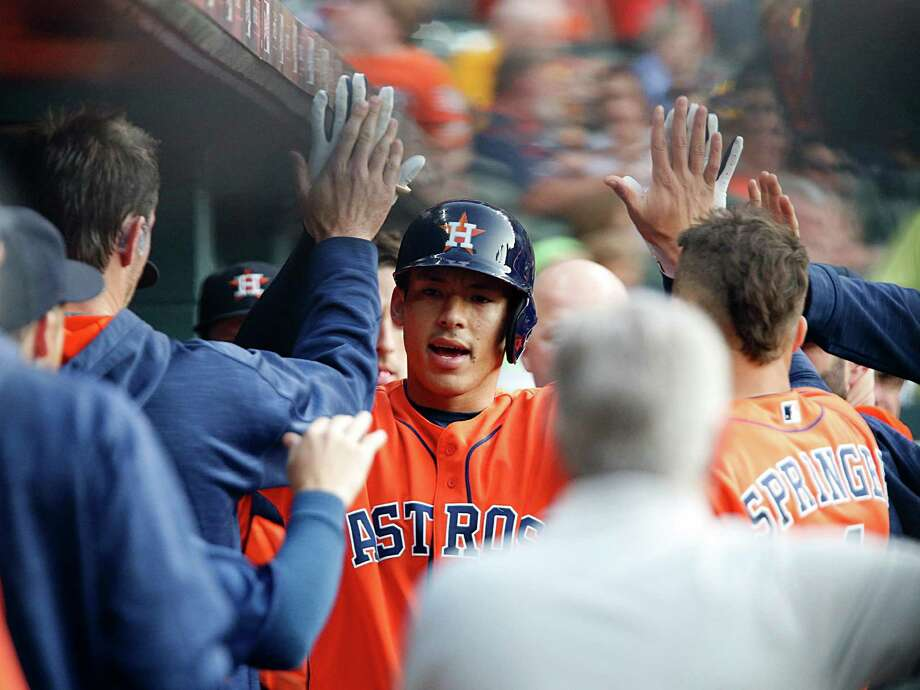 Astros shortstop Carlos Correa celebrates in the dugout after hitting a home run - one of his three hits - against the Mariners in the first inning. Photo: James Nielsen, Staff / © 2016  Houston Chronicle