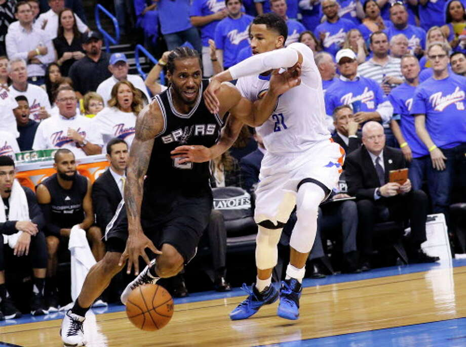 San Antonio Spurs forward Kawhi Leonard (2) drives to the basket around Oklahoma City Thunder guard Andre Roberson (21) during the second half of Game 3 of a second-round NBA basketball playoff series, Friday, May 6, 2016, in Oklahoma City. San Antonio won 100-96. (AP Photo/Alonzo Adams) Photo: Associated Press