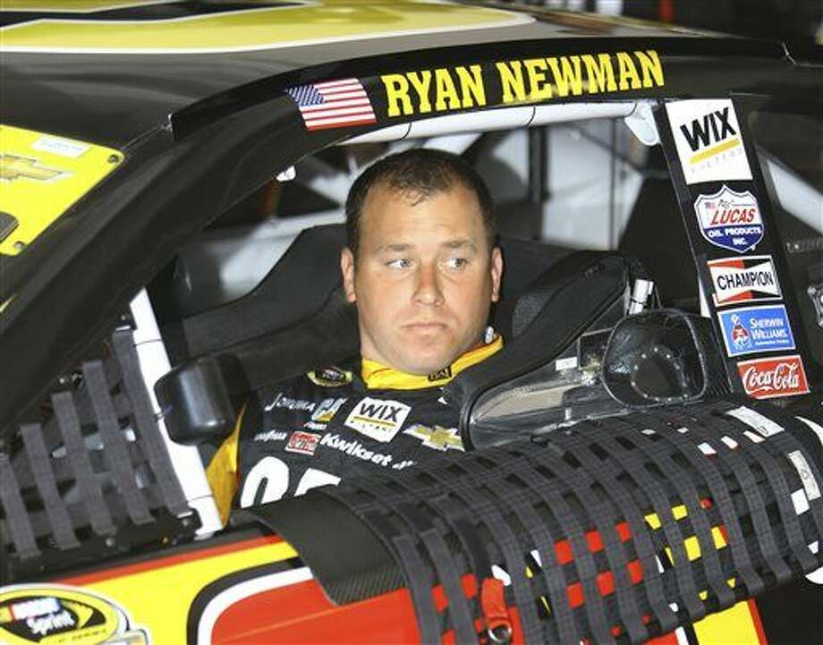 NASCAR auto racing driver Ryan Newman sits in his car as he waits to drive practice laps Friday, Nov. 14, 2014, in Homestead, Fla. (AP Photo/David Graham) Photo: David Graham