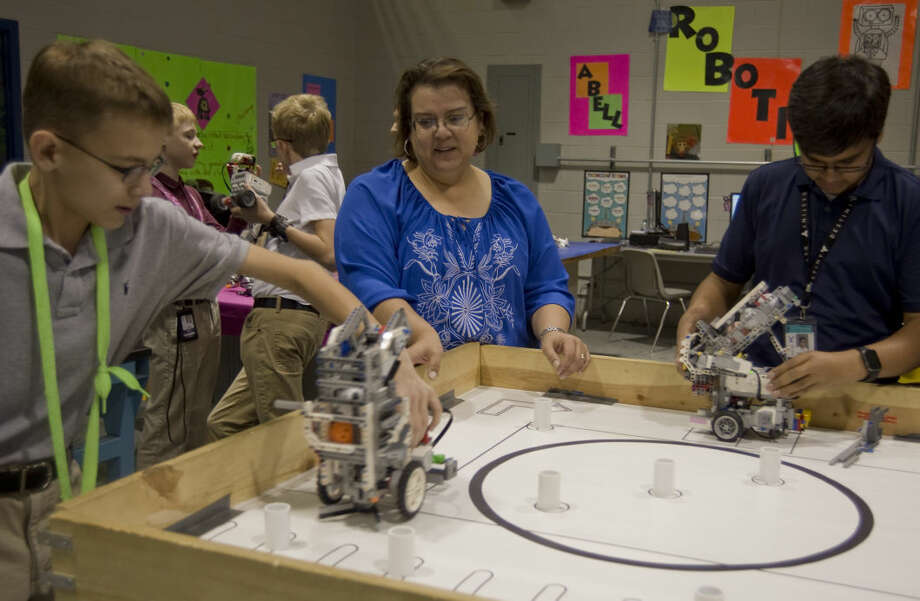 """Barbara Terrazas,Robotics and science teacher at Abell Junior High.""""My goal is to make a difference in the lives and education of students.I want students to never stop learning and always be curious."""" Photo: Tim Fischer"""