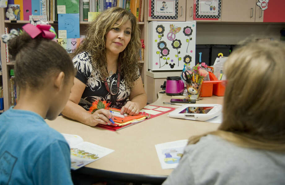 "Lisa Dominguez, second-grade teacher at Pease Communication and Technology Academy""I want all my students to know that they are in control of their education. The effort that they put into their learning will help to determine their future. I also remind them that they are blessed to have an opportunity to learn because not all children in other countries get the same opportunity to go to school and to learn."" Photo: Tim Fischer"