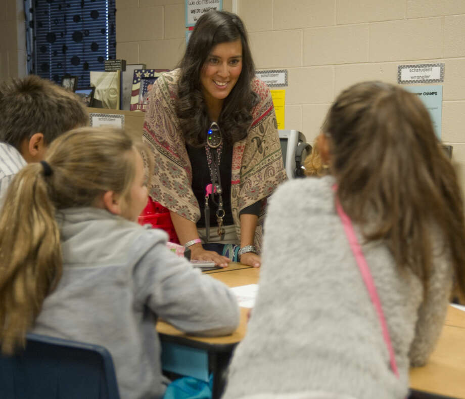 "Cristal Gonzalez, fifth-grade science and social studies teacher at Scharbauer Elementary.""We need to remember that all students are not all the same. They come from different backgrounds and home lives. We need to make connections with our students and get to know them. It makes a difference if you know what the students' interests are and how they live at home. The students respond better to teachers who care and want to help them."" Photo: Tim Fischer"