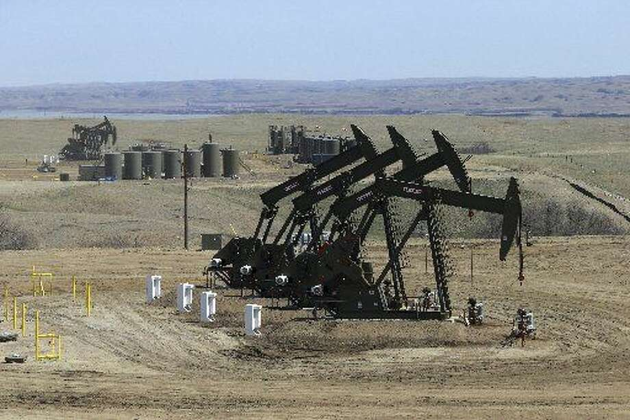 Pump jacks extract oil in Williston, N.D., where wells have proliferated. Photo: Associated Press