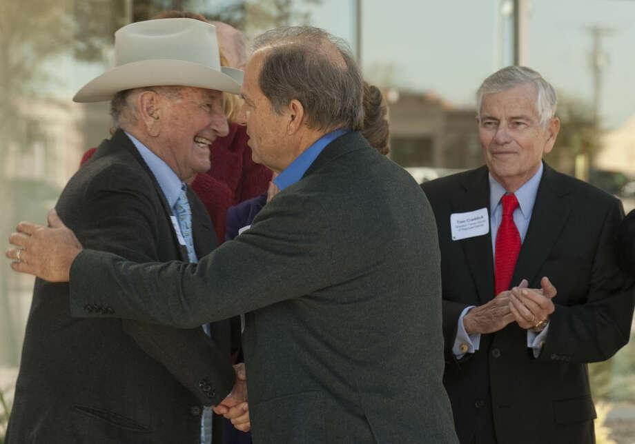 Clayton Williams and Scott Sheffield shake hands during the ceremonial opening of the new Pioneer Natural Resources building at ClayDesta Wednesday. Tim Fischer\Reporter-Telegram Photo: Tim Fischer