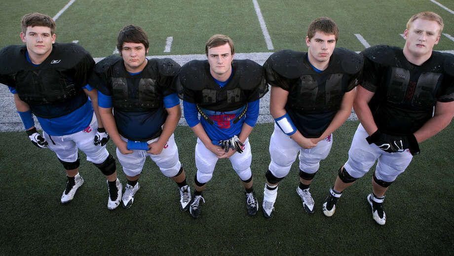 Midland Christian offensive linemen from left, Luke Fisher, Corey Joe Potter, Jacob Tucker, Bryson Breeding and Johnny Wilson, photographed before team practice Wednesday at Mustang Field. James Durbin/Reporter-Telegram Photo: James Durbin
