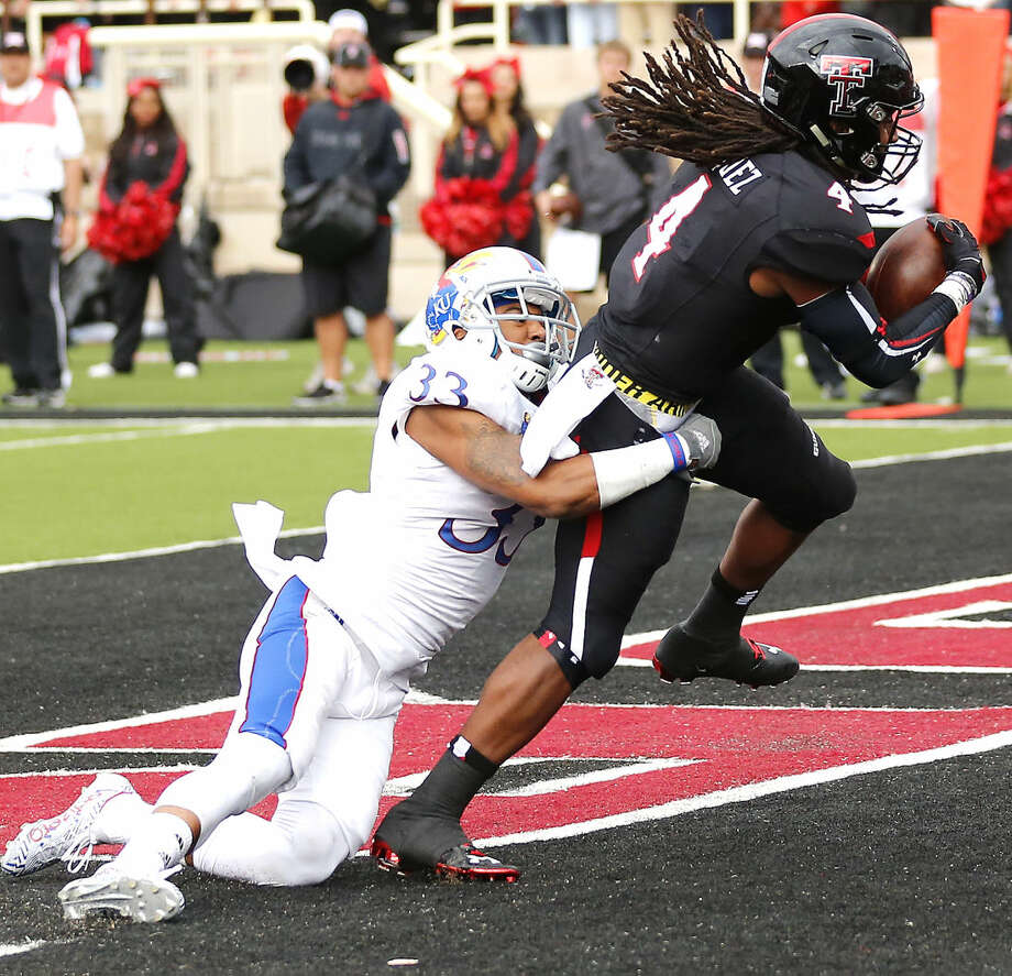 Tech receiver Bradley Marquez hauls in a touchdown pass for the Red Raiders in Saturdays Big XII matchup with the Kansas Jayhawks. Photo: Wade H Clay